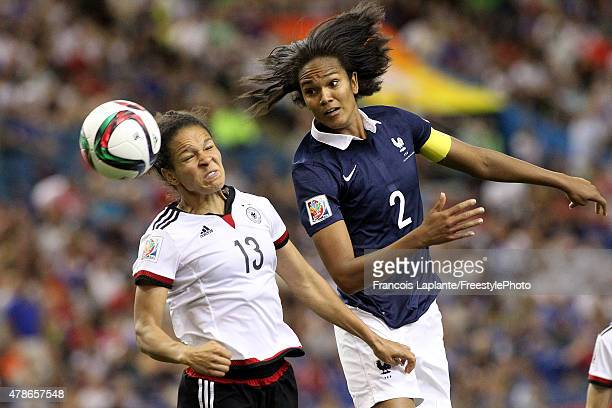 Wendie Renard of France heads the ball against Celia Sasic of Germany during the FIFA Women's World Cup Canada 2015 quarter final match between...