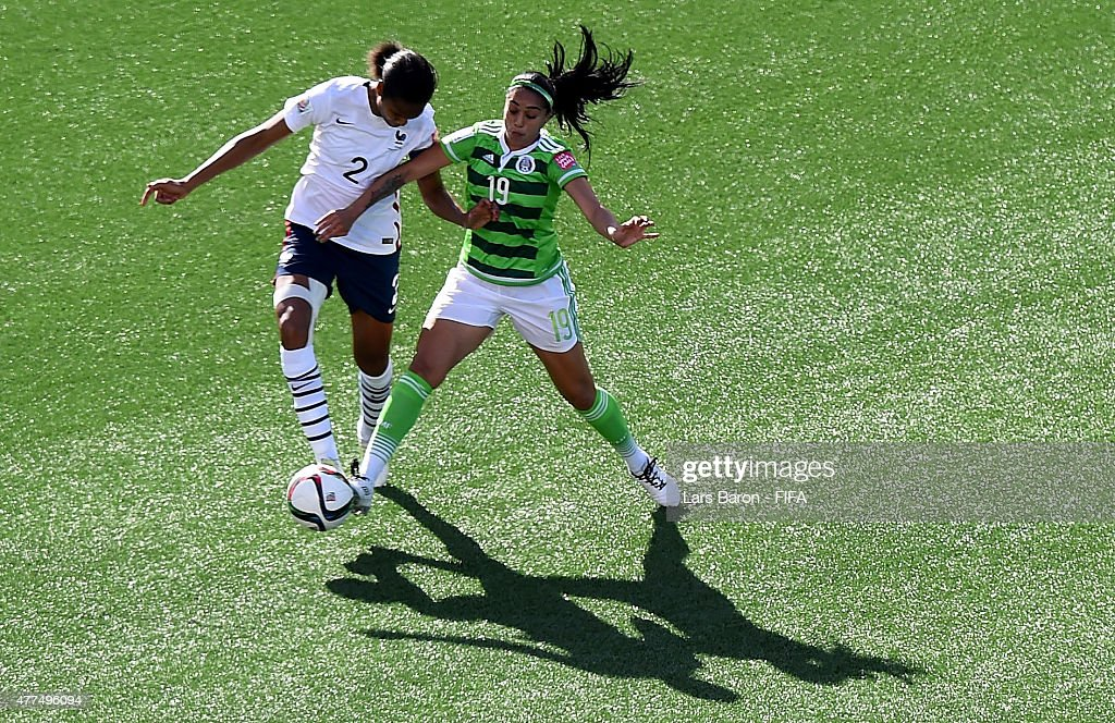 Wendie Renard of France is challenged by Renae Cuellar of Mexico during the FIFA Women's World Cup 2015 Group F match between Mexico and France at Lansdowne Stadium on June 17, 2015 in Ottawa, Canada.