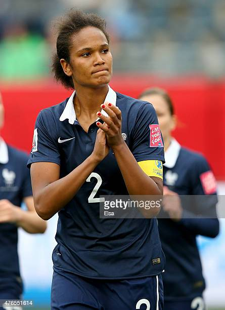 Wendie Renard of France salutes the fans after the match against England during the FIFA Women's World Cup 2015 Group F match at Moncton Stadium on...