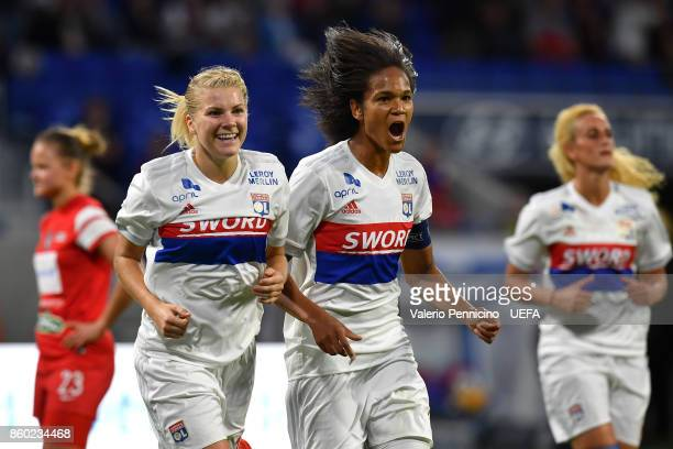 Wendie Renard of Lyon celebrates a goal with team mate Ada Hegerberg during the UEFA Women's Champions League Round of 32 Second Leg match between...