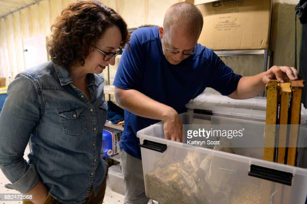 Wendy Lu McGill CEO of The Rocky Mountain Micro Ranch and COO Kyle Conrad work inside a storage container in the Westwood neighborhood in the states...