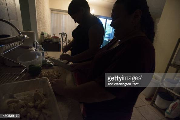 Wendy right prepares dinner with her 14 year old daughter who fled El Salvador Photographed in their home on June 10 in Hyattsville MD NOTE Subjects...