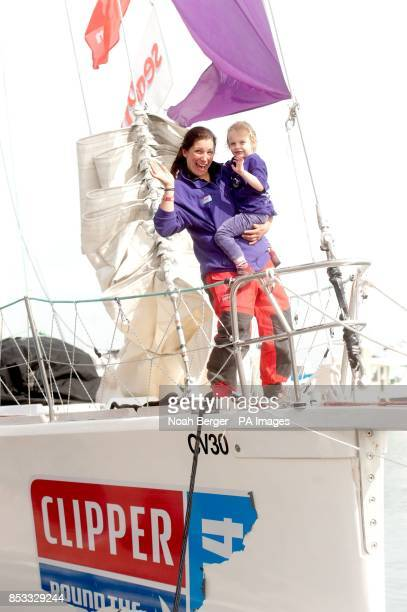 Wendy White a crewmember with Derry~Londonderry~Doire celebrates as her boat arrives in San Francisco after racing from China in the Clipper Round...