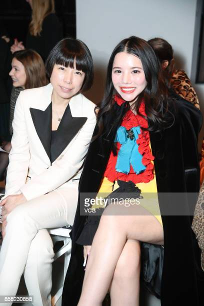 Wendy Yu and Vogue China editor Angelica Cheung attend the Giambattista Valli show as part of the Paris Fashion Week Womenswear Spring/Summer 2018 on...