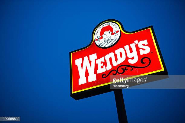 Wendy's Co signage is displayed outside of a restaurant in Daly City California US on Sunday Aug 7 2011 Wendy's Co the operator of more than 6500...