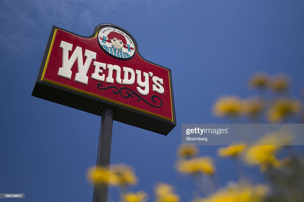 Wendy's Co. signage is displayed outside of a restaurant in Daly City, California, U.S., on Tuesday, May 7, 2013. Wendy's Co. is expected to release earnings data on May 8. Photographer: David Paul Morris/Bloomberg via Getty Images