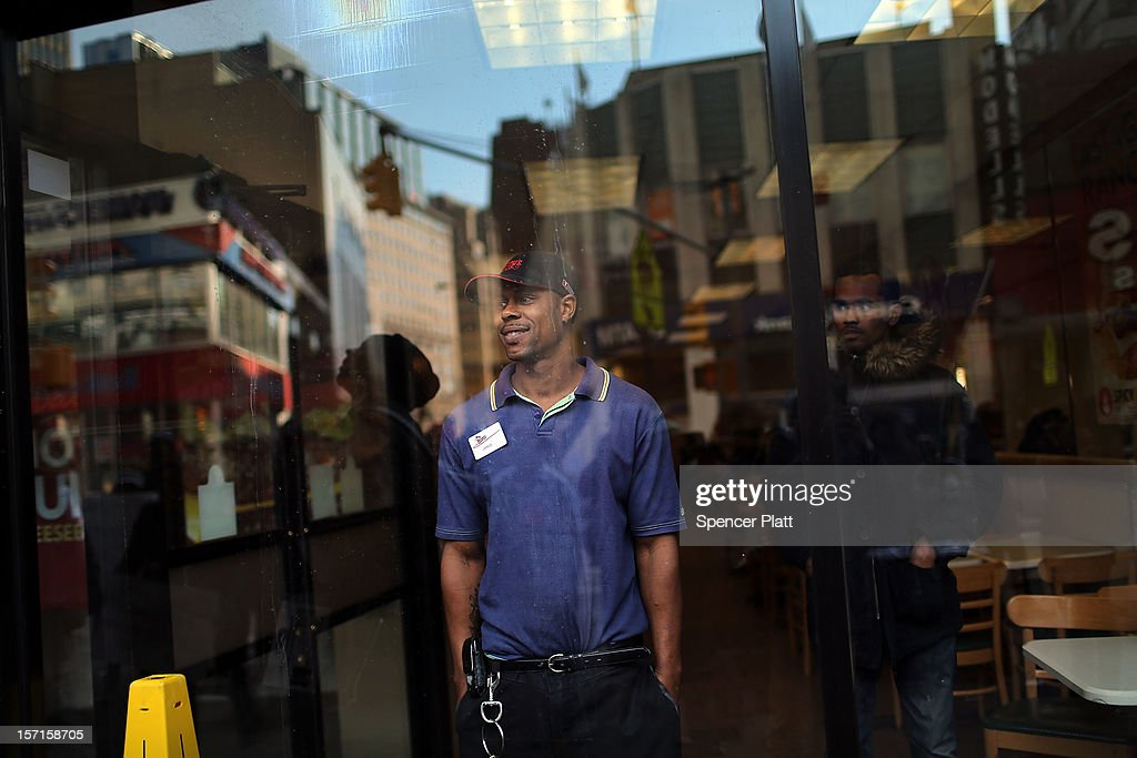 A Wendy's employee looks out of a window as protesters, many of them also employees at Wendy's fast-food restaurant, demonstrate outside of one of the restaurants to demand higher pay and the right to form a union on November 29, 2012 in New York City. The campaign, called 'Fast Food Forward,' organized protests at other New York fast-food establishments including McDonald's, Burger King, KFC, Pizza Hut, Taco Bell and Domino's. The group seeks to double hourly pay to $15 an hour .