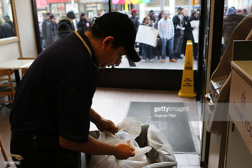 A Wendy's employee works as protesters, many of them also employees at Wendy's fast-food restaurant, demonstrate outside of one of the restaurants to demand higher pay and the right to form a union on November 29, 2012 in New York City. The campaign, called 'Fast Food Forward,' organized protests at other New York fast-food establishments including McDonald's, Burger King, KFC, Pizza Hut, Taco Bell and Domino's. The group seeks to double hourly pay to $15 an hour .