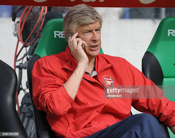 Wenger Arsene Football Manager France Arsenal London Club using his mobile phone
