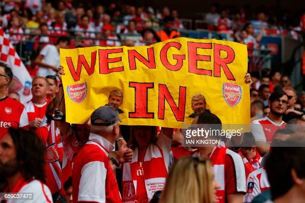 Wenger supporters hold up a placard in the crown ahead of the English FA Cup final football match between Arsenal and Chelsea at Wembley stadium in...