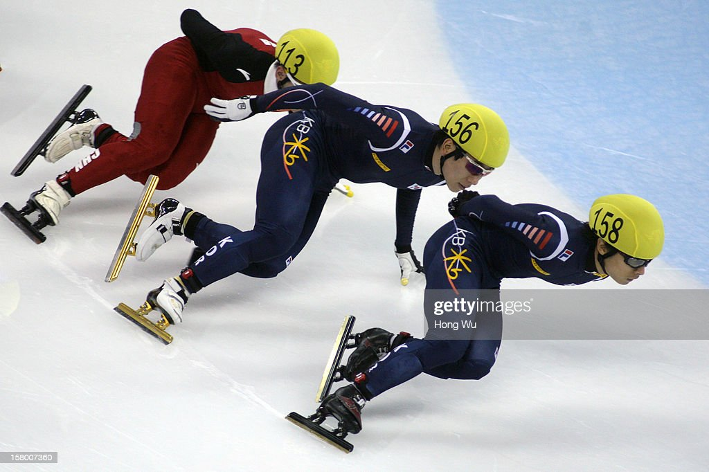 Wenhao Liang of China, Byeong-Jun Kim of Korea, Yoon-Gy Kwak of Korea compete in the Men's 1000m Final during the day one of the ISU World Cup Short Track at the Oriental Sports Center on December 8, 2012 in Shanghai, China.