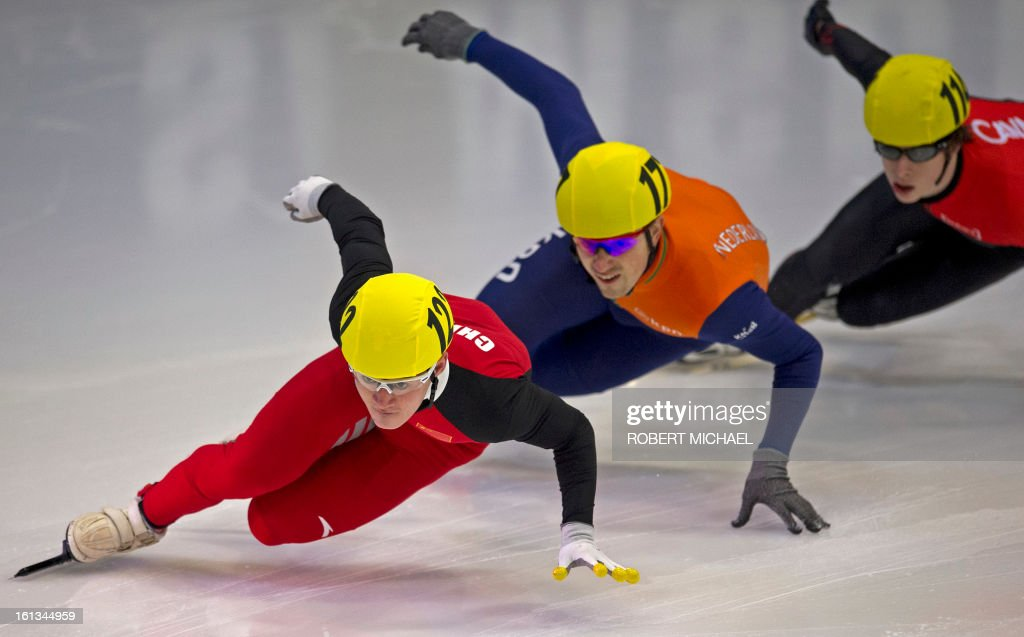 Wenhao Liang of China leads the pack at the men's 500m quarter final race of the ISU World Cup short track speed skating event in Dresden, eastern Germany, on February 10, 2013.