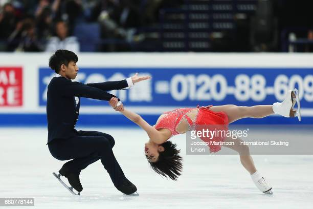 Wenjing Sui and Cong Han of China compete in the Pairs Free Skating during day two of the World Figure Skating Championships at Hartwall Arena on...