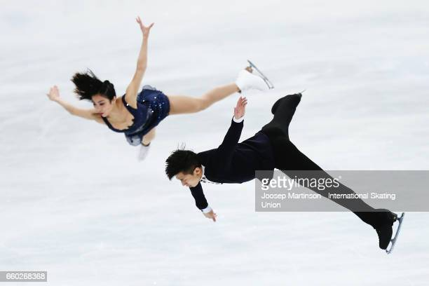 Wenjing Sui and Cong Han of China compete in the Pairs Short Program during day one of the World Figure Skating Championships at Hartwall Arena on...