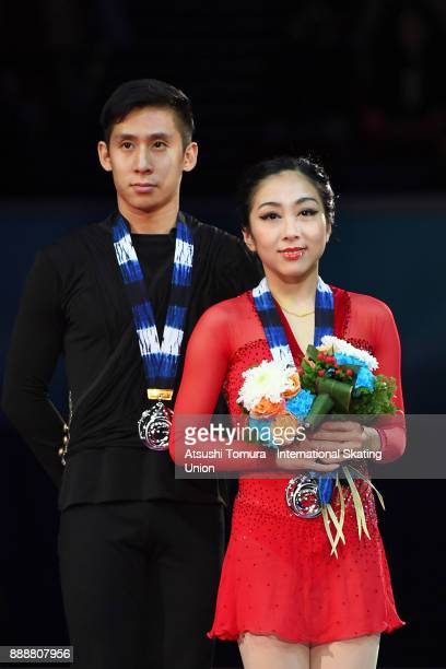 Wenjing Sui and Cong Han of China pose on the podium after the Pairs free skating during the ISU Junior Senior Grand Prix of Figure Skating Final at...