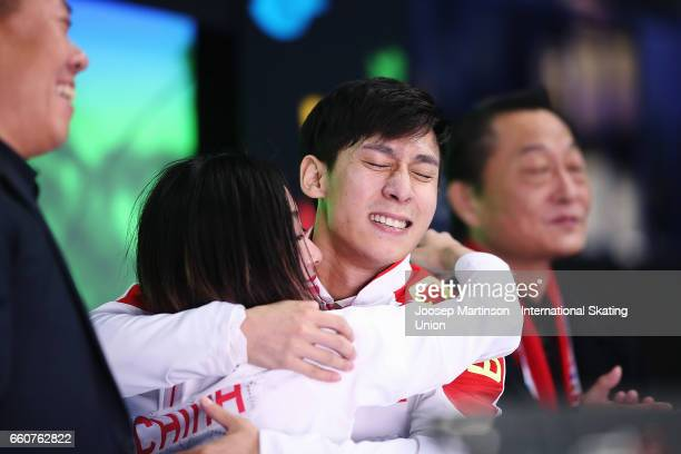 Wenjing Sui and Cong Han of China react at kiss and cry in the Pairs Free Skating during day two of the World Figure Skating Championships at...