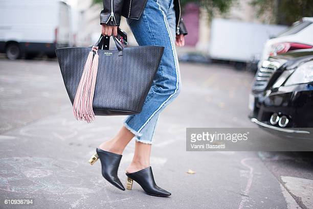 Wenjun Lau poses wearing a Uooya jacket Topshop jeans and Meli Mele bag after the Lanvin show at the Hotel de Ville during Paris Fashion Week...