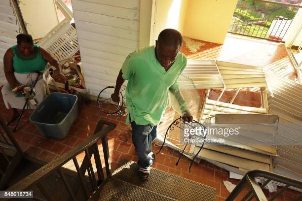 Wentworth Drew and his wife Ielet King remove valuables from their apartment at the Tutu High Rise after looters broke in following Hurricane Irma...