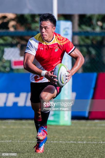 Wenzhen Li of China runs for a try during the Asia Rugby U20 Sevens 2017 at King's Park Sports Ground on August 5 2017 in Hong Kong Hong Kong