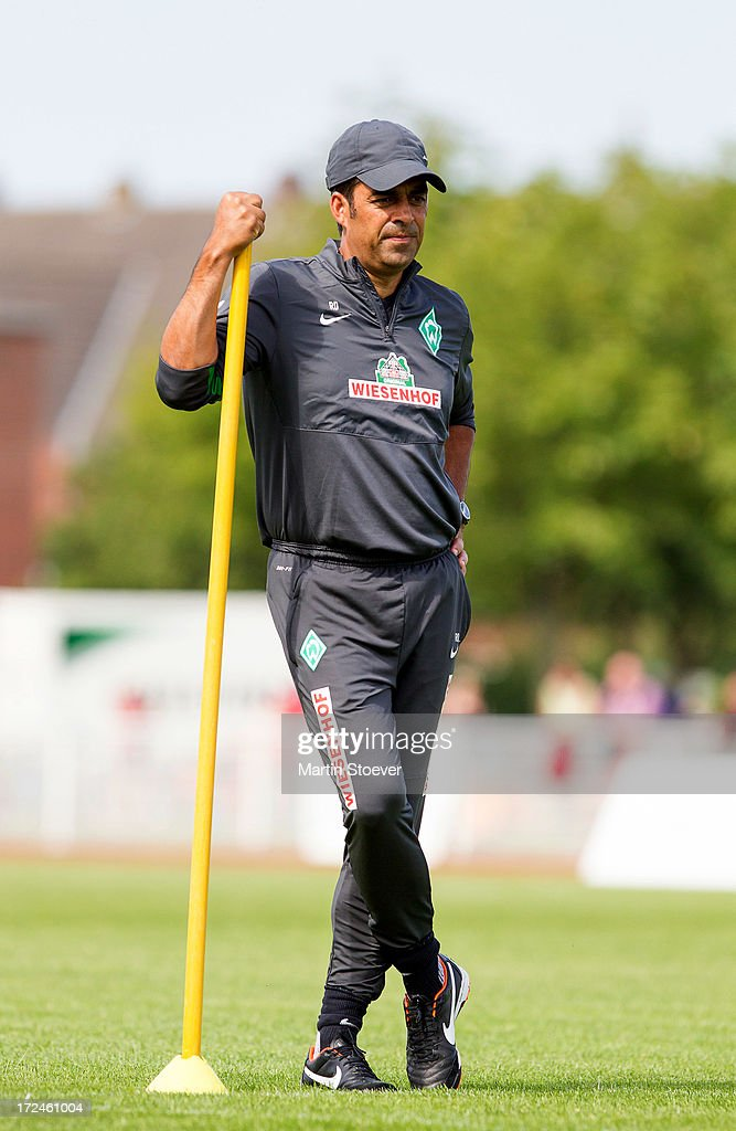 Werder Bremen coach, <a gi-track='captionPersonalityLinkClicked' href=/galleries/search?phrase=Robin+Dutt&family=editorial&specificpeople=3175490 ng-click='$event.stopPropagation()'>Robin Dutt</a> looks on during a training session on July 2, 2013 in Norderney, Germany.