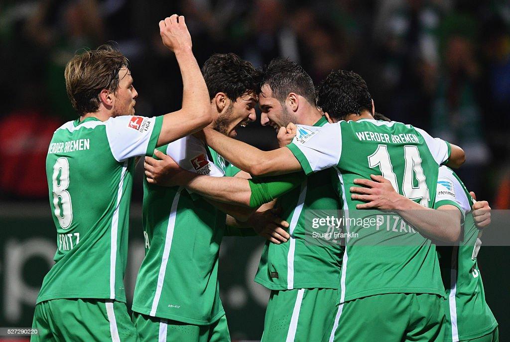Werder Bremen players celebrate as Fin Bartels of Werder Bremen scores their fifth goal during the Bundesliga match between Werder Bremen and VfB Stuttgart at Weserstadion on May 2, 2016 in Bremen, Germany.