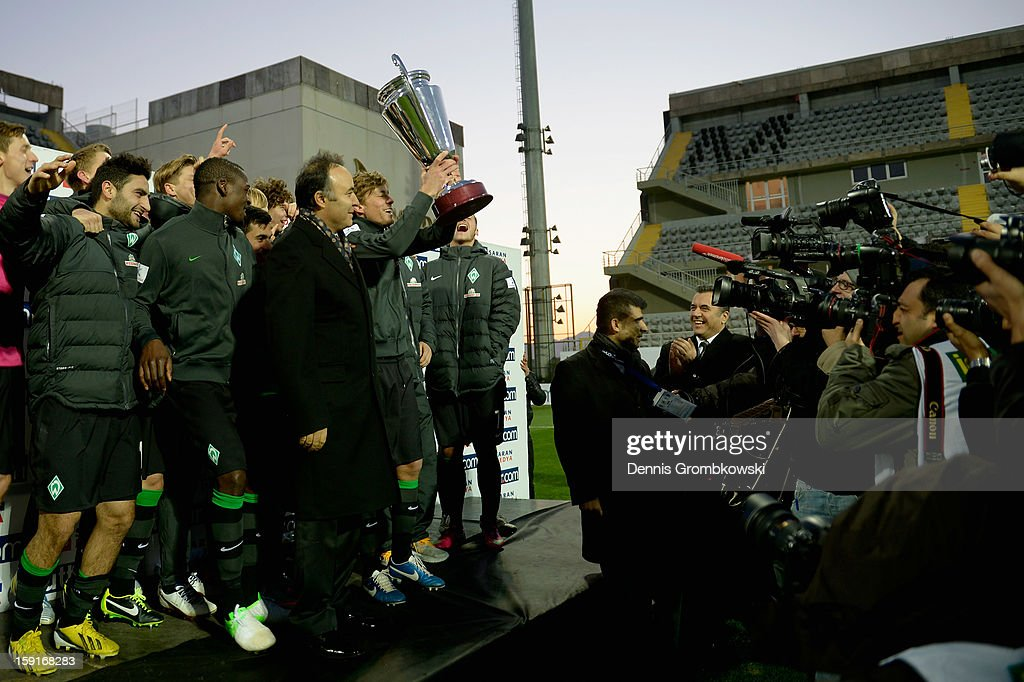 Werder Bremen players pose with the Tuttor Cup trophy after the friendly match between Werder Bremen and VfL Wolfsburg at Mardan Palace Stadium on January 9, 2013 in Kundu, Turkey.