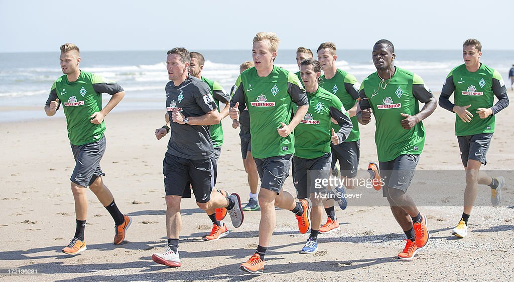 Werder Bremen players run on the beach during a training session on July 2, 2013 in Norderney, Germany.