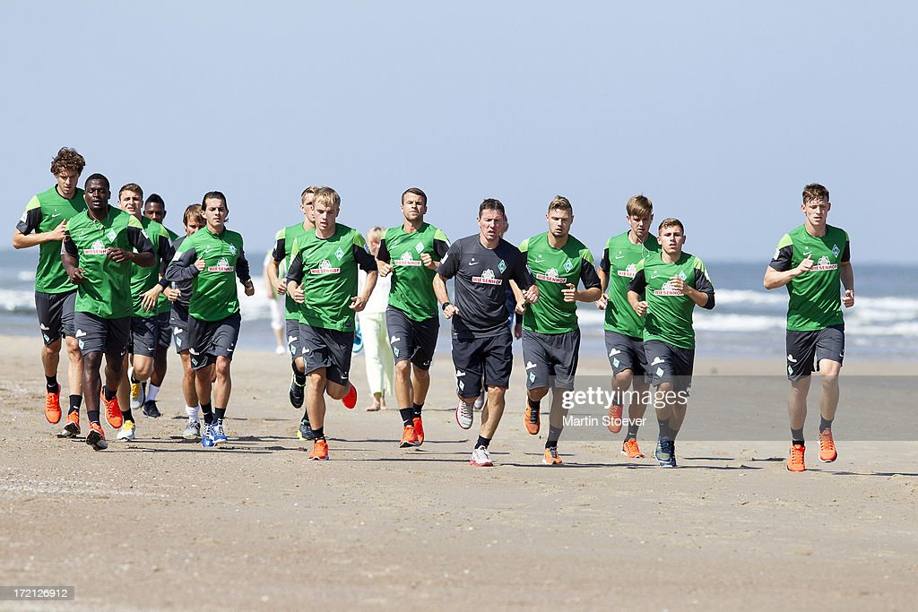 Werder Bremen players runs on the beach during a training session on July 2, 2013 in Norderney, Germany.