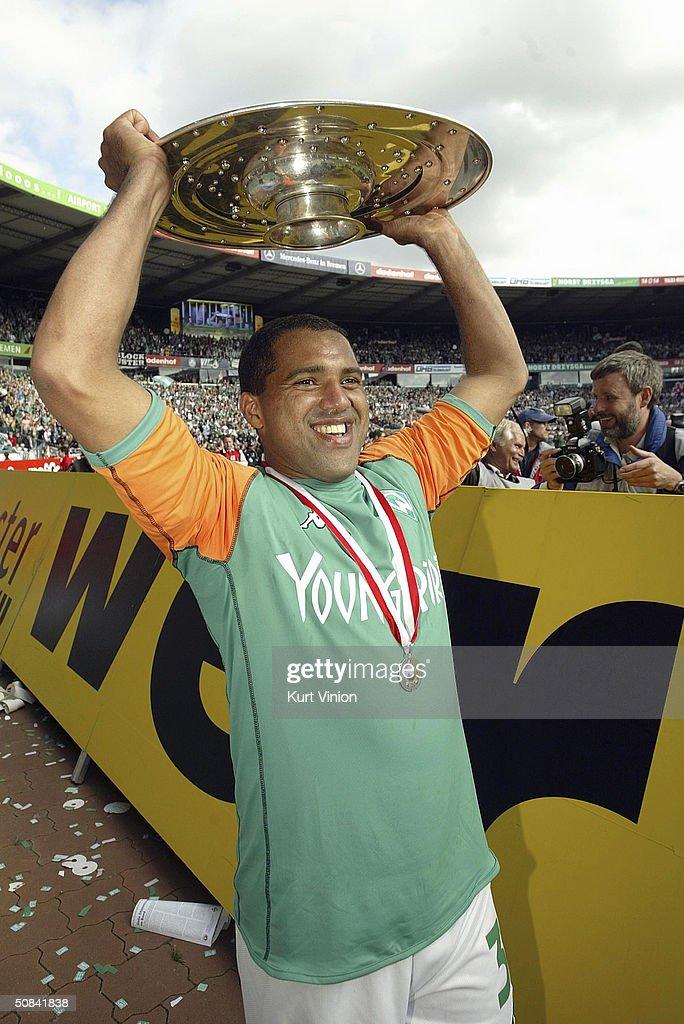 Werder Bremen's Ailton celebrates his teams Bundesliga Championship with the trophy in Bremen May 15 2004 in Bremen Germany Werder Bremen sealed...