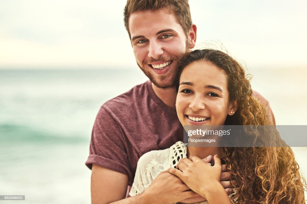 We're just a couple of beach lovers : Stock Photo