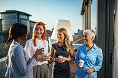 Portrait of successful business women drinking coffee.