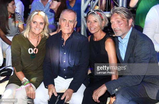 Werner Boeck owner of fashion label Marc O'Polo his wife and Elfi Boeck Mads Mikkelsen and his wife Hanne Jacobsen attend the fashion show during the...