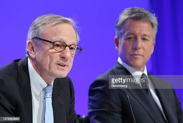 Werner Brandt chief financial officer of SAP AG left speaks as Bill McDermott cochief executive officer of SAP AG listens during a news conference in...