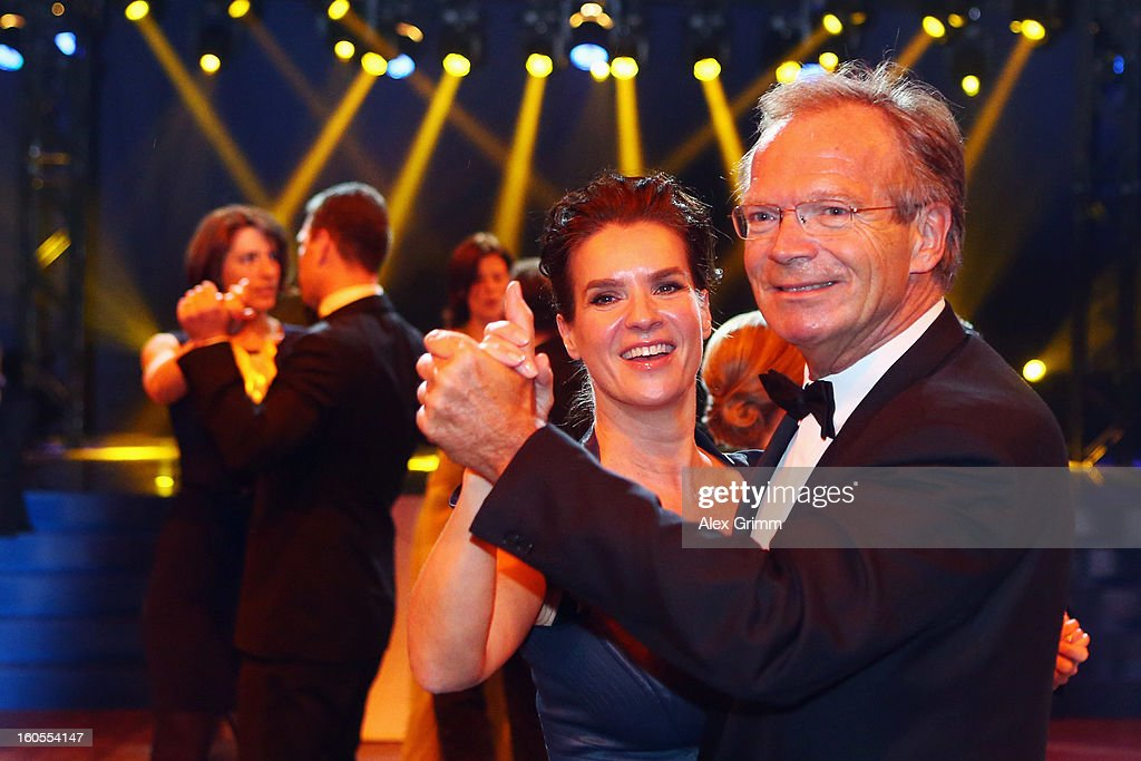 <a gi-track='captionPersonalityLinkClicked' href=/galleries/search?phrase=Werner+E.+Klatten&family=editorial&specificpeople=2080173 ng-click='$event.stopPropagation()'>Werner E. Klatten</a> dances with <a gi-track='captionPersonalityLinkClicked' href=/galleries/search?phrase=Katarina+Witt&family=editorial&specificpeople=203221 ng-click='$event.stopPropagation()'>Katarina Witt</a> during the 'Ball des Sports 2013' at Rhein-Main-Hallen on February 2, 2013 in Wiesbaden, Germany.