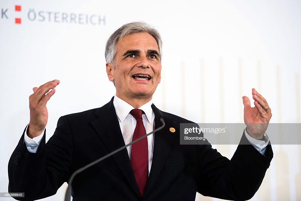 <a gi-track='captionPersonalityLinkClicked' href=/galleries/search?phrase=Werner+Faymann&family=editorial&specificpeople=4101130 ng-click='$event.stopPropagation()'>Werner Faymann</a>, Austria's chancellor, gestures as he speaks during a news conference at the Western Balkans Summit in Vienna, Austria, on Thursday, Aug. 27, 2015. German Chancellor Angela Merkel said the region's refugee crisis is unworthy of European values as she called for more efforts to grapple with the tide of those seeking safe haven. Photographer: Akos Stiller/Bloomberg via Getty Images