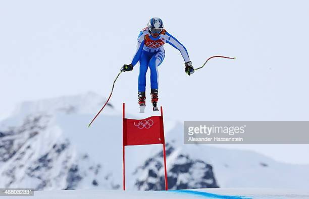 Werner Heel of Italy skis during the Alpine Men's Downhill on day two of the Sochi 2014 Winter Olympics at Rosa Khutor Alpine Center on February 9...