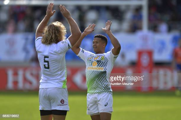 Werner Kok and Dewald Human of South Africa react after their victory during the HSBC Paris sevens final match between Scotland and South Africa on...