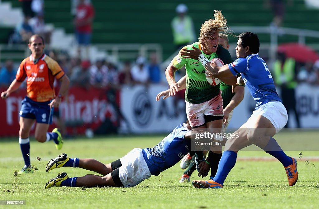 Werner Kok of South Africa in action against Samoa during the Emirates Dubai Rugby Sevens HSBC Sevens World Series at The Sevens Stadium on December...