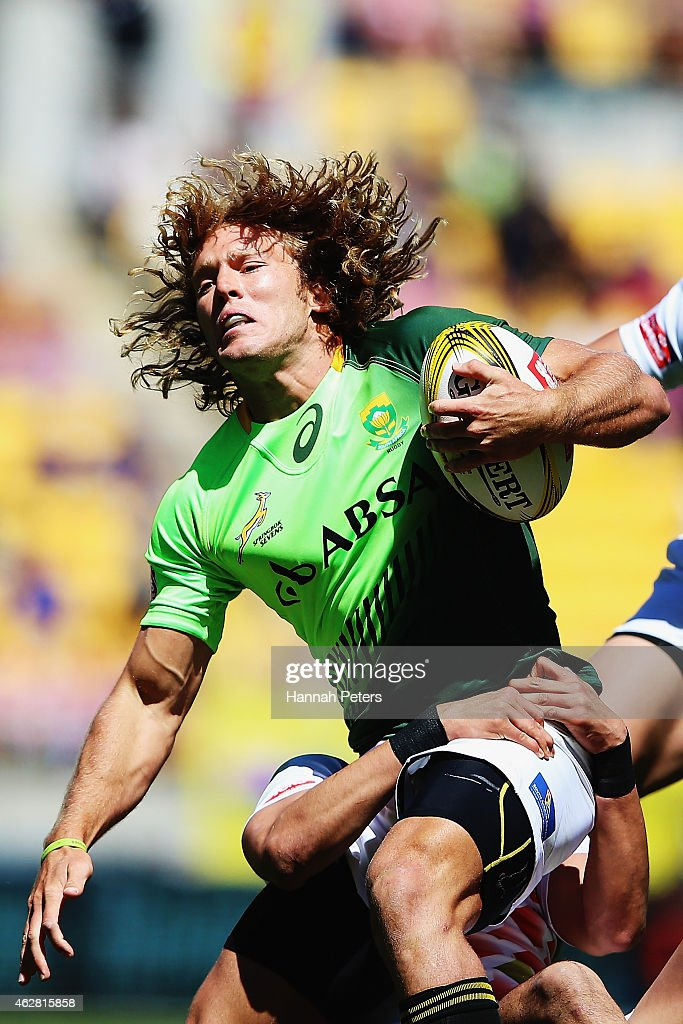 Werner Kok of South Africa is brought down during the match between Japan and South Africa in the 2015 Wellington Sevens at Westpac Stadium on...