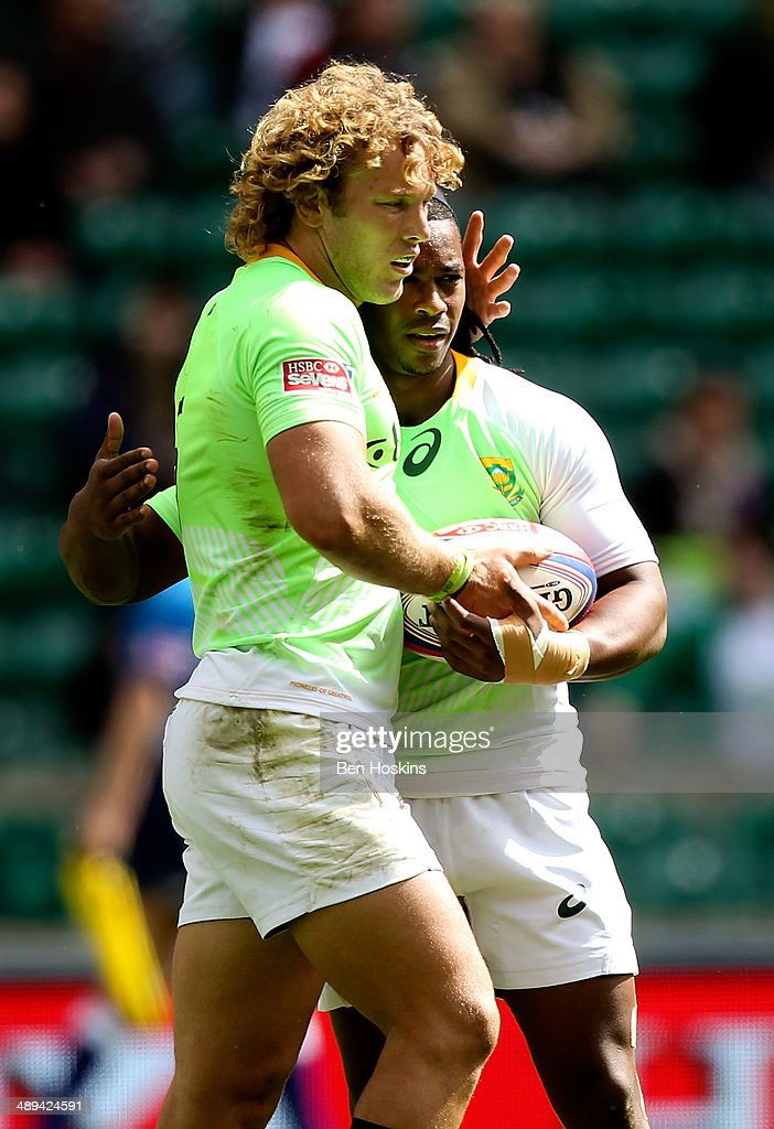 Werner Kok of South Africa is congratulated by team mate Branco du Preez after scoring a try during the Marriott London Sevens match between Scotland...
