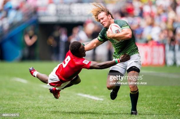 Werner Kok of South Africa is tackled during the 2017 Hong Kong Sevens match between South Africa and Kenya at Hong Kong Stadium on April 8 2017 in...