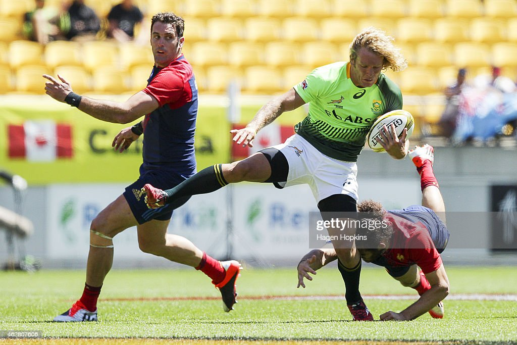 Werner Kok of South Africa is tackled during the match between France and South Africa in the 2015 Wellington Sevens at Westpac Stadium on February 6...
