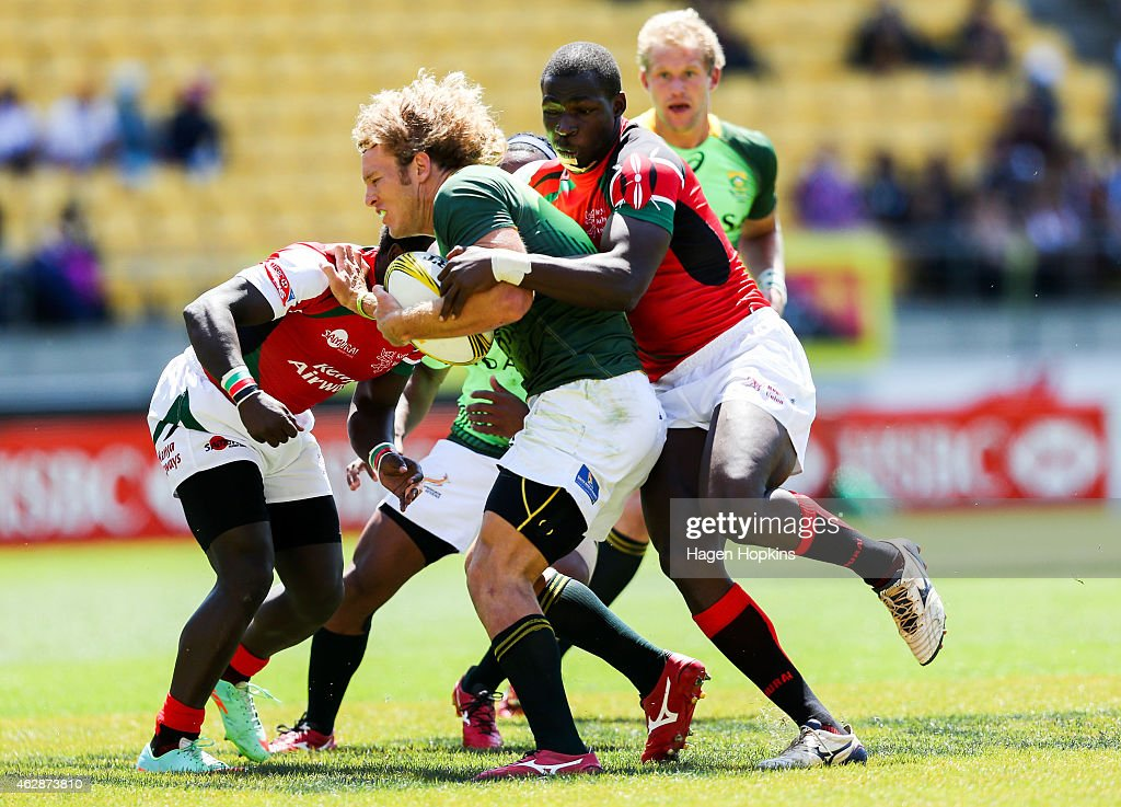Werner Kok of South Africa is tackled during the match between Kenya and South Africa in the 2015 Wellington Sevens at Westpac Stadium on February 7...