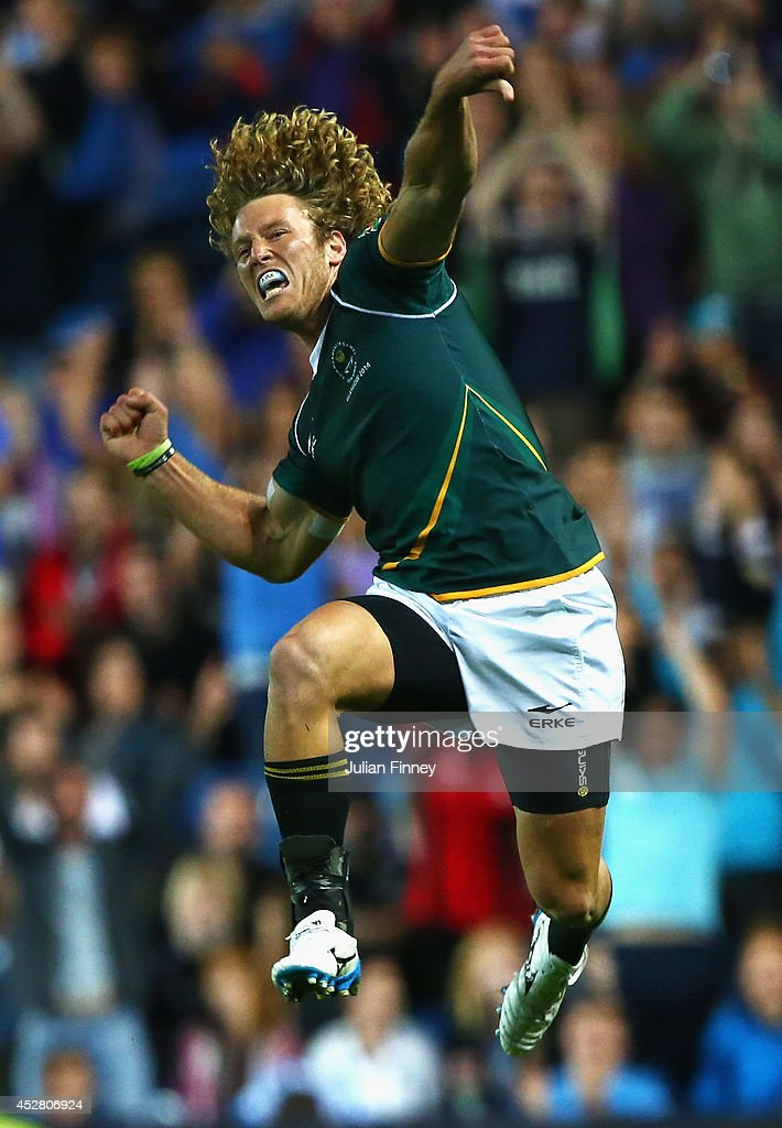 Werner Kok of South Africa jumps in the air to celebrate their win over New Zealand during the final match between South Africa and New Zealand at...