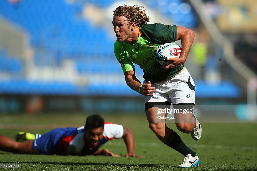 Werner Kok of South Africa makes a break during the 2014 Gold Coast Sevens Pool B match between American Samoa and South Africa at Cbus Super Stadium...