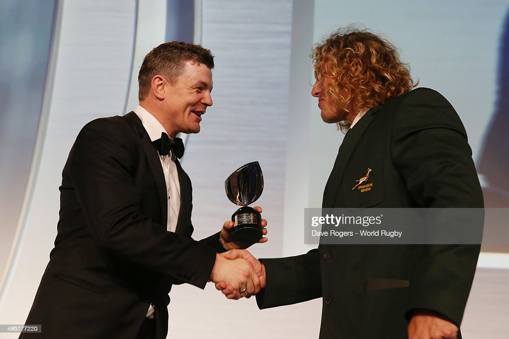 Werner Kok of South Africa receives the Men's 7's Player of the Year award from Brian O'Driscoll during the World Rugby Awards 2015 at Battersea...