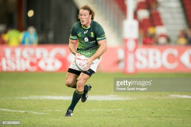 Werner Kok of South Africa runs with the ball during the match Fiji vs South Africa Day 2 of the HSBC Singapore Rugby Sevens as part of the World...