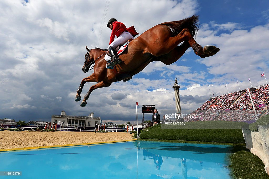 Werner Muff of Switzerland riding Kiamon competes in the 3rd Qualifier of Individual Jumping on Day 10 of the London 2012 Olympic Games at Greenwich...