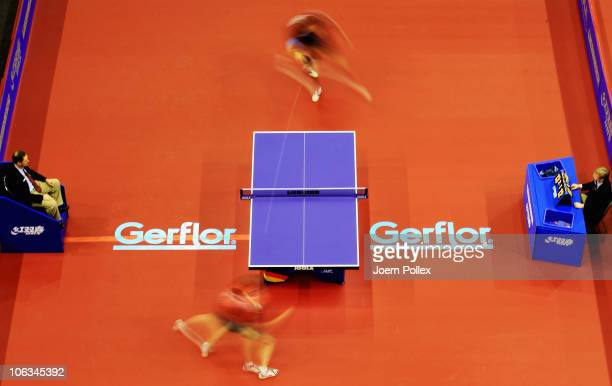 Werner Schlager of Austria and Vladimir Samsonov of Belarus compete during their Table Tennis World Cup 2010 match at the Boerdeland Hall on October...