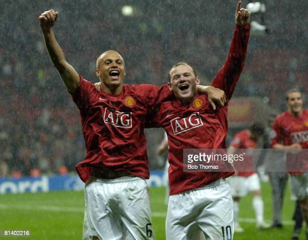 Wes Brown and Wayne Rooney of Manchester United celebrate victory in the UEFA Champions League Final between Manchester United and Chelsea held at...